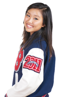 high school girl in varsity letterman jacket